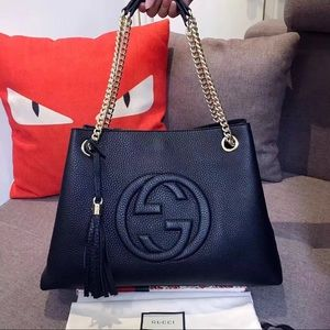 $  2  0  0  Gucci  bag